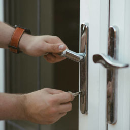 man-locking-patio-door-with-key