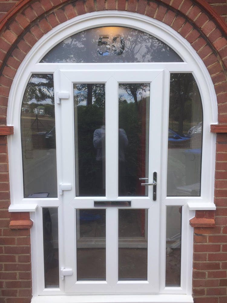 Arched-frame-with-door-insert-in-upvc