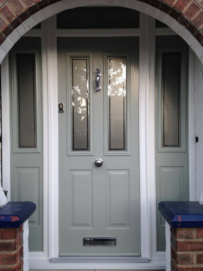 newly-fitted-pale-green-composite-front-door-with-side-lights