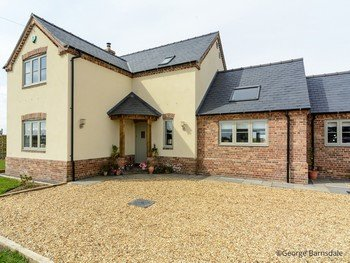 Quadring New Build Front of House AP image copyright of George Barnsdale 350x263 - TIMBER WINDOWS